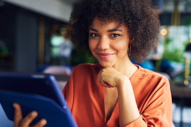 Portrait of beautiful African businesswoman at work stock photo