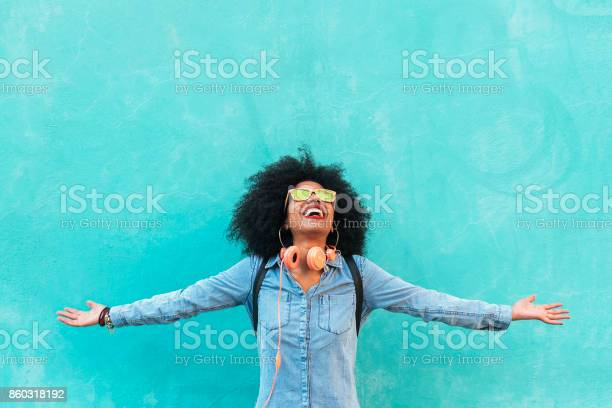 Portrait of beautiful afro american woman having fun in the street.