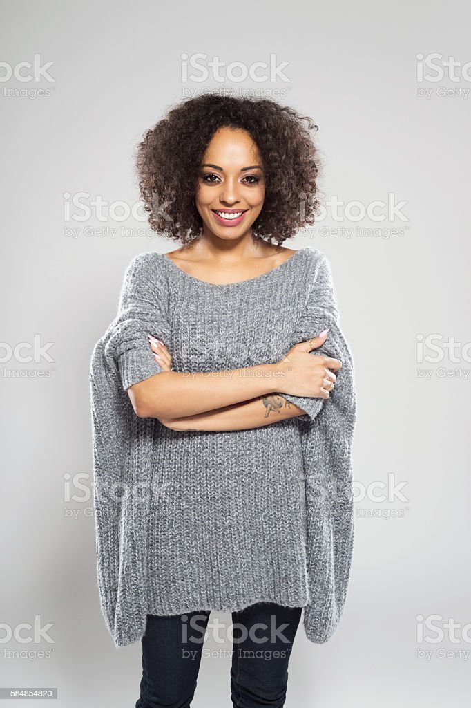 Portrait of beautiful afro american young woman wearing casual wool...