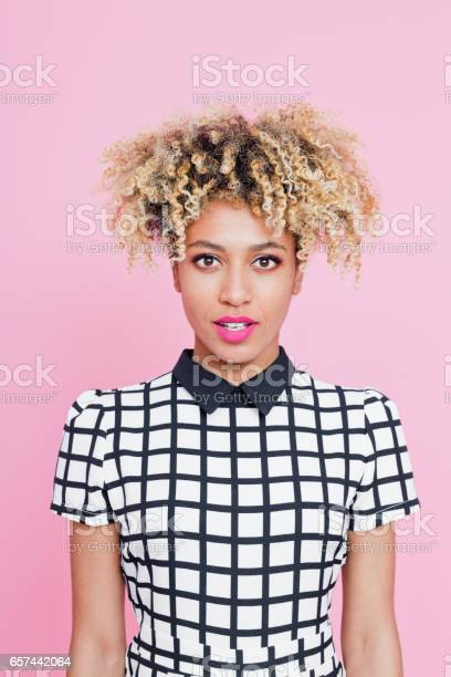 Portrait Of Beautiful Afro American Young Woman Wondering Stock Photo - Download Image Now