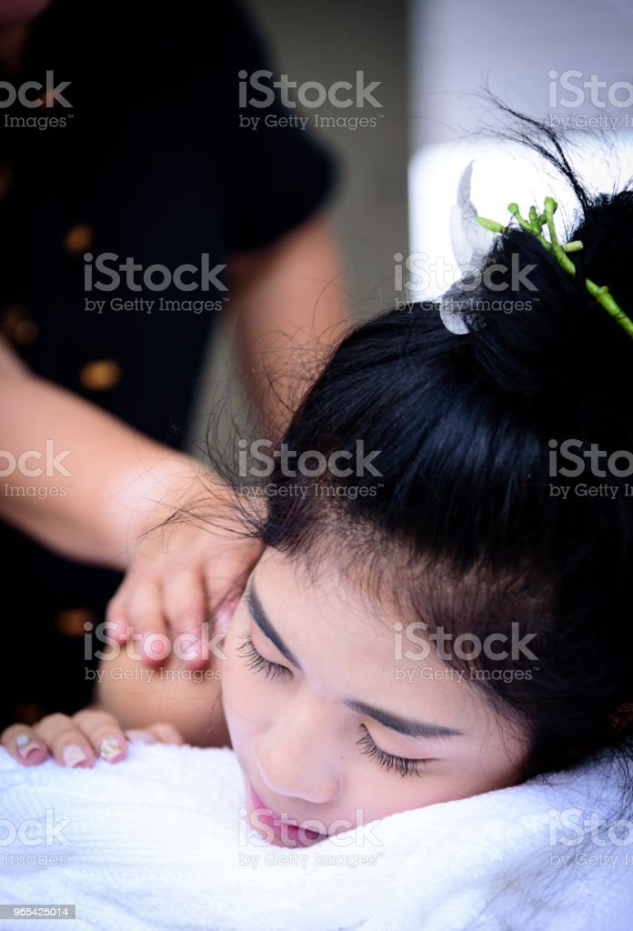 Portrait of beautiful asian people with close up view and close up eyes and having hand massage in spa salon. Beauty, healthy, spa and relaxation concept. royalty-free stock photo