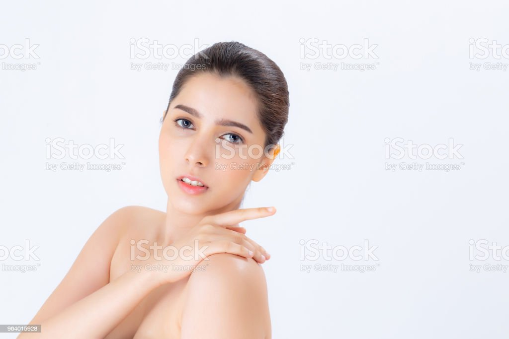 Portrait of beautiful asian woman makeup of cosmetic, girl touch  shoulder and smile attractive, face of beauty perfect with wellness isolated on white background with skin healthcare concept. - Royalty-free Adult Stock Photo