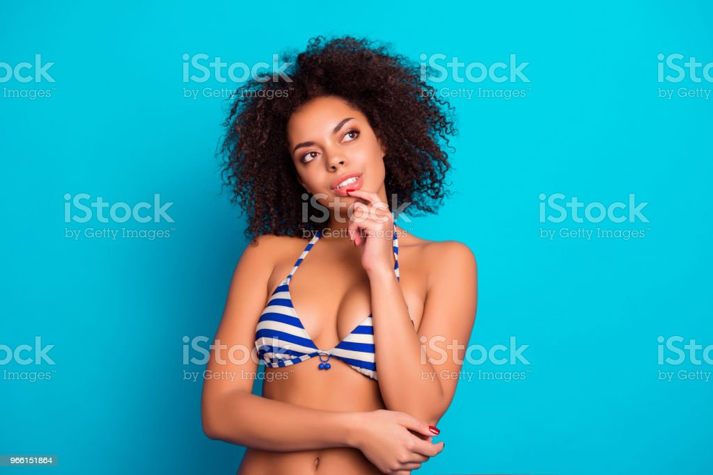 Portrait of beautiful attractive  lovely cute tender gentle thoughtful with lush brown curly hair afro woman, she is planning her trip to islands and sea, isolated on bright blue background - Royalty-free Adult Stock Photo