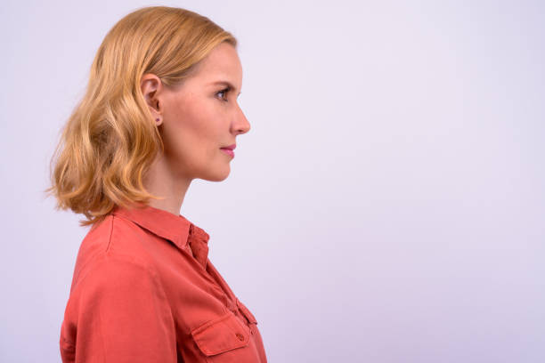 Portrait Of Beautiful Blonde Woman Portrait Of Beautiful Blonde Woman Against White Background profile view stock pictures, royalty-free photos & images