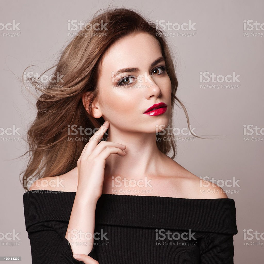 Portrait of beautiful blonde woman with curly hairstyle stock photo
