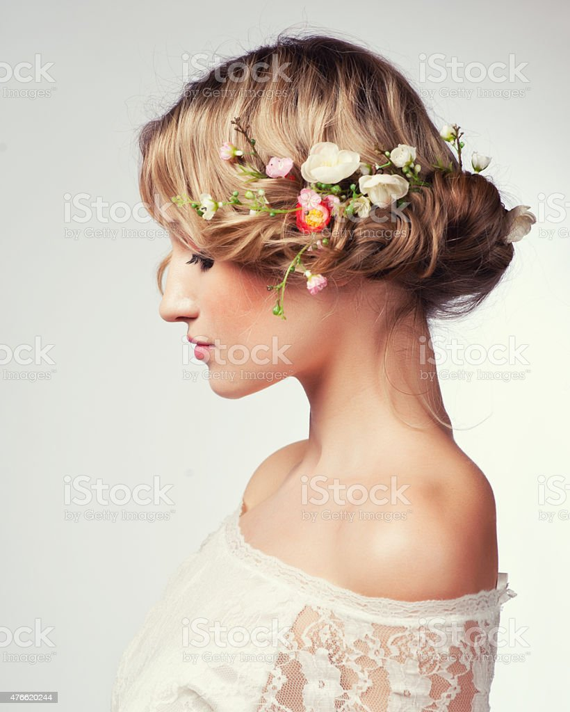 Portrait of  beautiful blonde woman with flowers in her hair stock photo