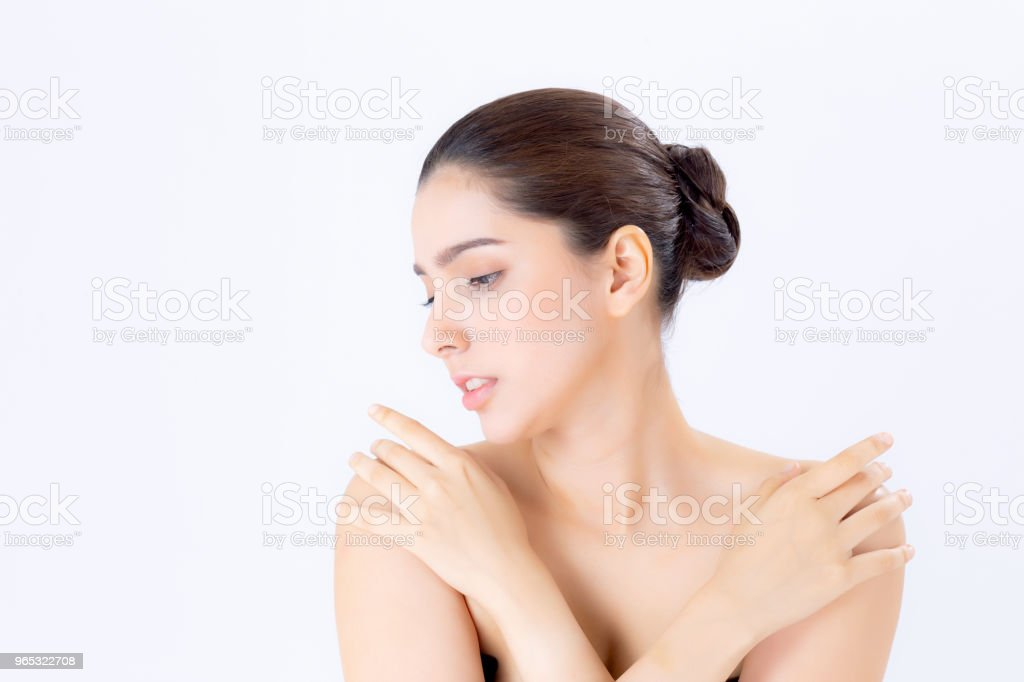 Portrait of beautiful brunette woman makeup of cosmetic, girl hand touch shoulder and smile attractive, face of beauty perfect with wellness isolated on white background with skin healthcare concept. zbiór zdjęć royalty-free
