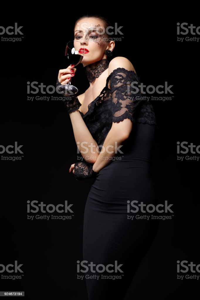 9a8d84c23 Portrait Of Beautiful Brunette Woman Sommelier In Lacy Black Dress ...