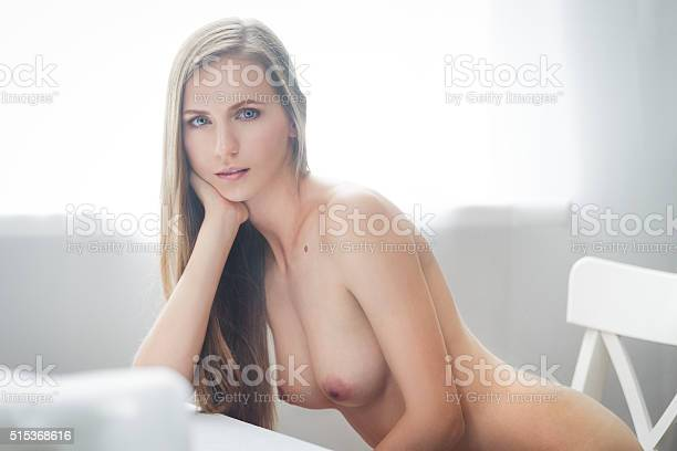 Close-up portrait of beautiful brunette young topless woman.