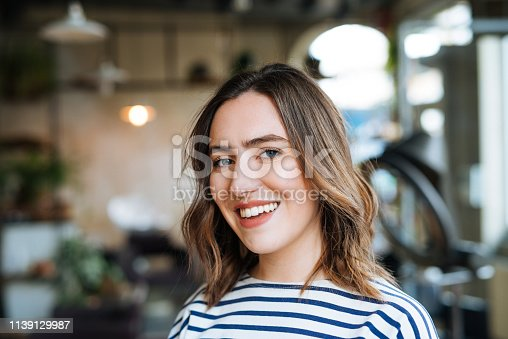 istock Portrait of beautiful caucasian millennial woman with blue eyes 1139129987