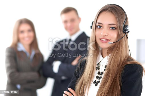 istock Portrait of beautiful cheerful smiling call operator on the background of business people. Successful call center concept 690408940