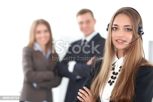 istock Portrait of beautiful cheerful smiling call operator on the background of business people. Successful call center concept 696548704