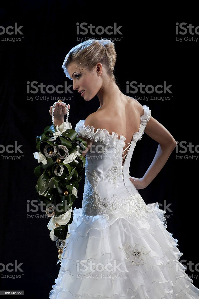 Portrait of Beautiful Elegant Bride Standing with Bouquet. royalty-free stock photo