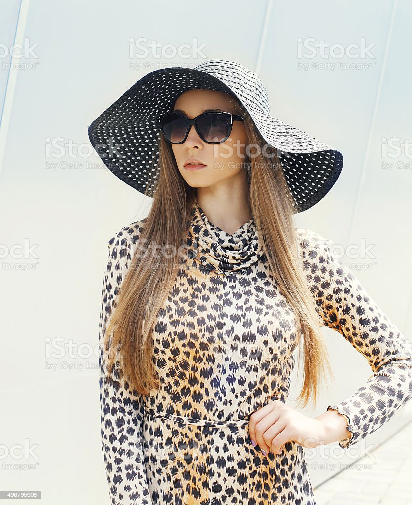 Portrait of beautiful elegant woman wearing a leopard dress, str stock photo