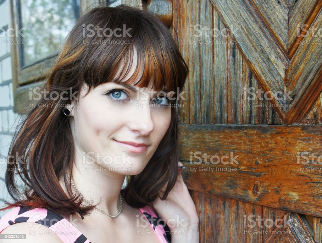 Portrait of beautiful european young woman with blue eyes stock photo