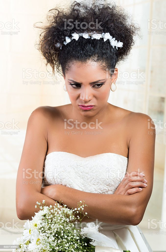 Portrait of beautiful exotic emotional bride looking angry stock photo