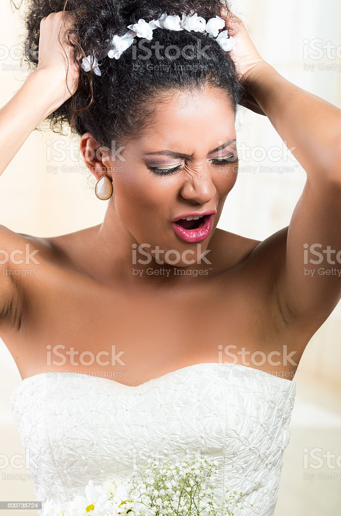 Portrait of beautiful exotic emotional bride looking desperate stock photo