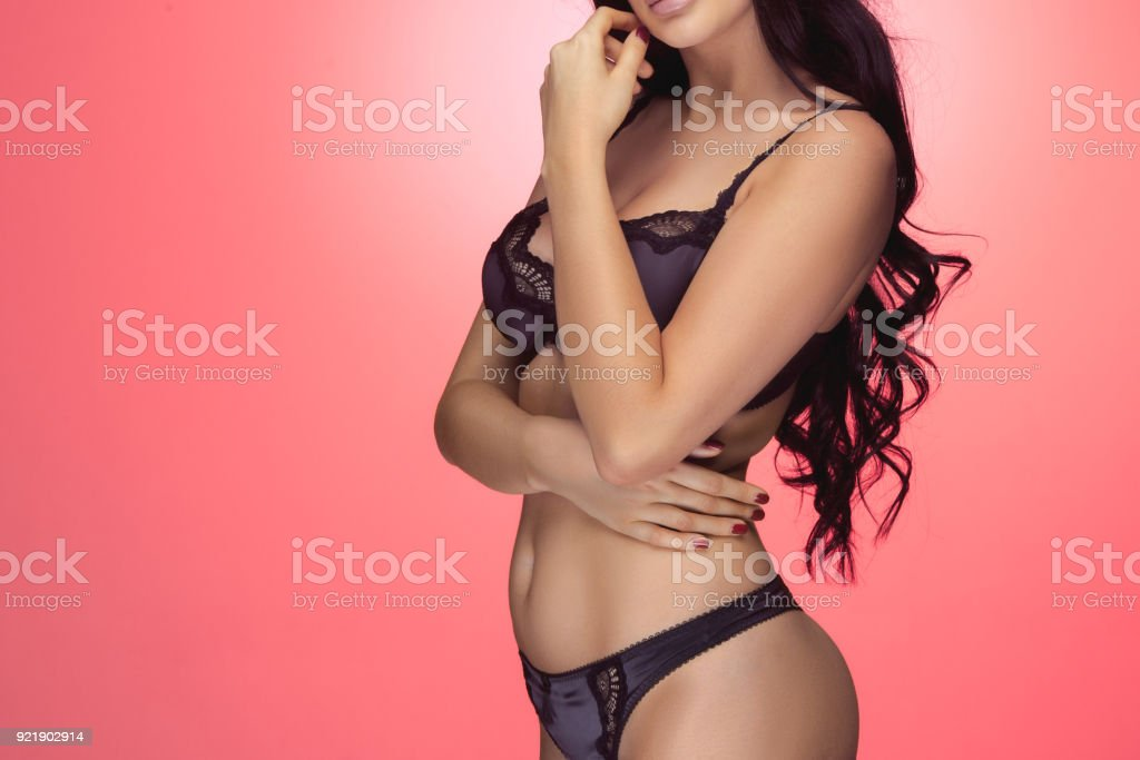 e3cb89339 Portrait of beautiful fat woman in lingerie or underwear posing in studio -  Stock image .