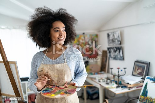 istock Portrait of beautiful fine artist with palette and paintbrush 1141968779
