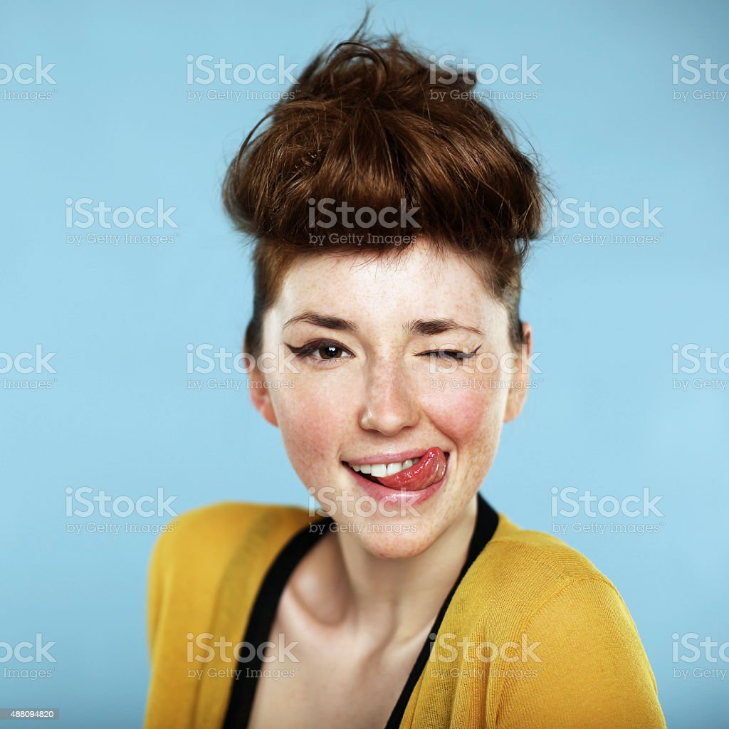 Portrait of beautiful freckled young woman stock photo