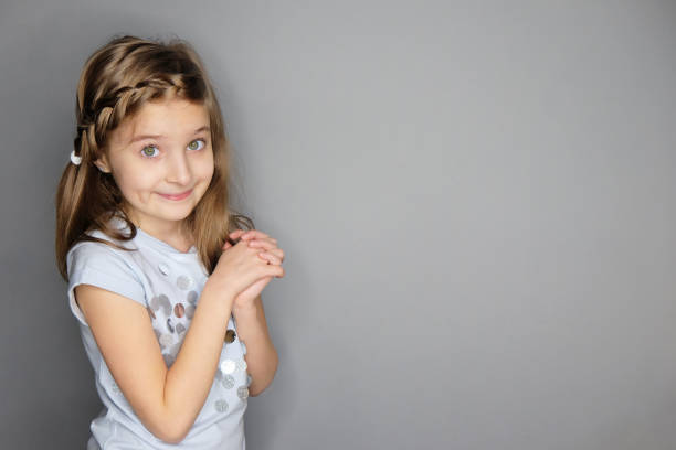 Portrait of beautiful funny smiling little girl stock photo