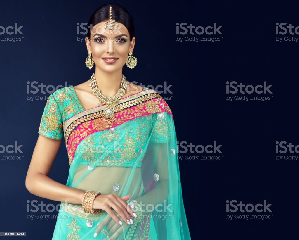 Portrait Of Beautiful Girl Dressed In A Traditional Indian National Suit Jewelry Set Blouse