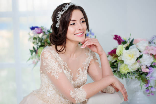 Portrait of beautiful girl in a luxurious wedding dress. Bride with beautiful decoration in her hair stock photo