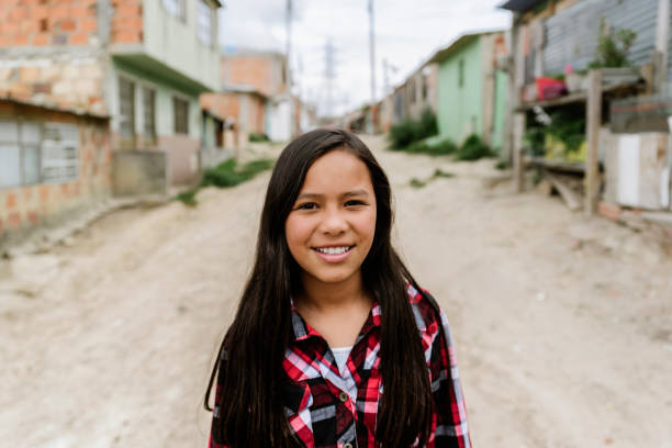 Portrait of beautiful girl in shanty town. stock photo
