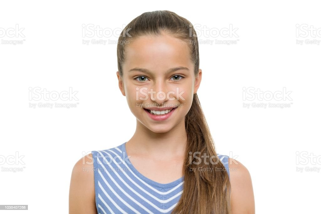 Portrait of beautiful girl of 10, 11 years old. Child with perfect white smile, isolated on white background – zdjęcie