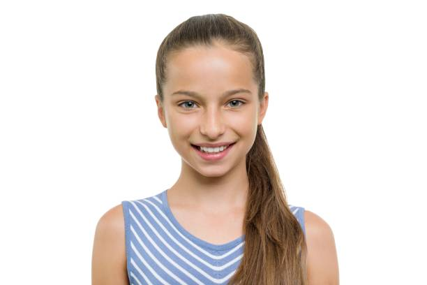 Portrait of beautiful girl of 10, 11 years old. Child with perfect white smile, isolated on white background stock photo