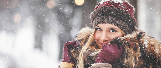 portrait of beautiful girl outdoors while showing - warm clothing stock photos and pictures