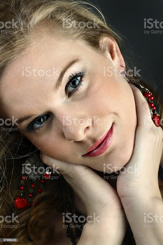 Portrait of beautiful girl touching her neck royalty free stockfoto