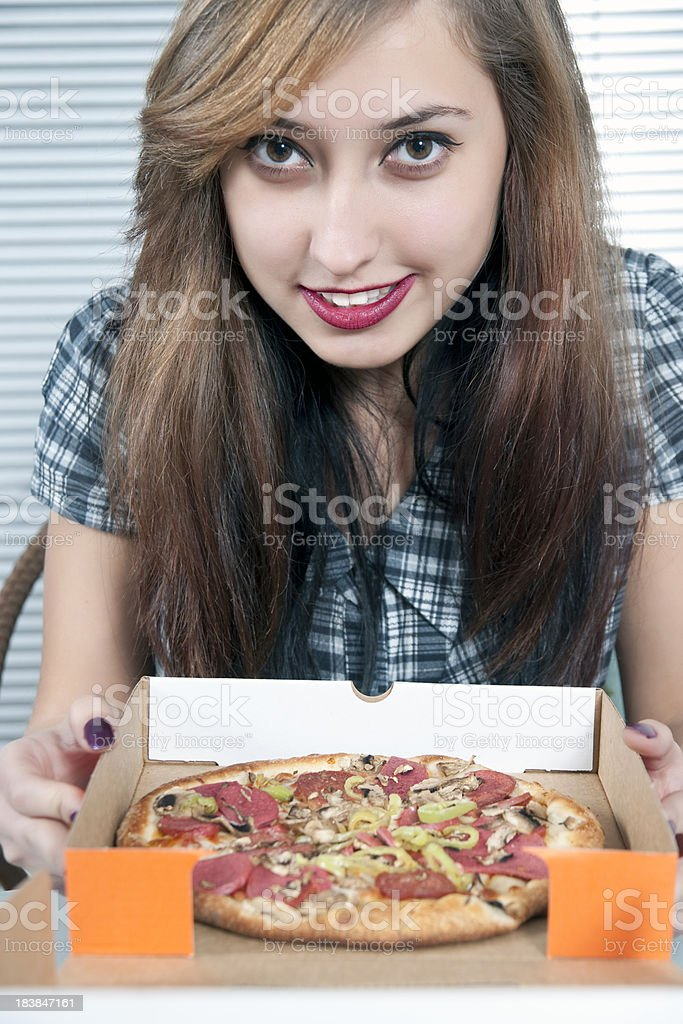 Portrait of beautiful girl with a pizza royalty-free stock photo