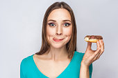 istock Portrait of beautiful girl with chocolate donuts. 801447046