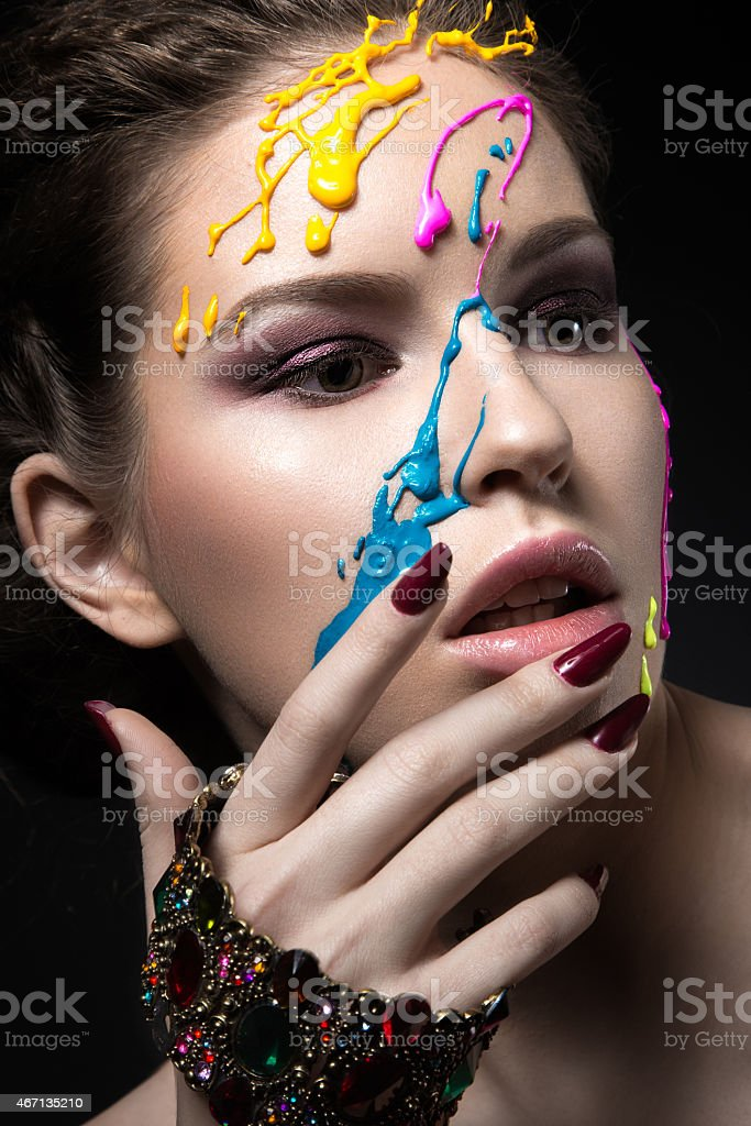 Portrait of beautiful Girl with color paint on her face. stock photo