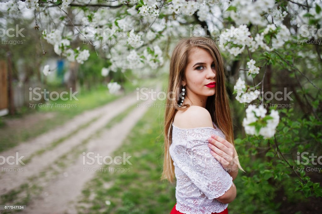 Portrait of beautiful girl with red lips, wear on red dress and white blouse. royalty-free stock photo