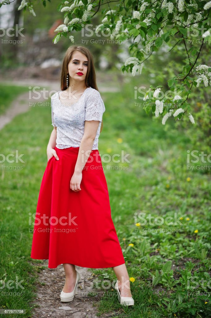 Portrait of beautiful girl with red lips , wear on red dress and white blouse. royalty-free stock photo