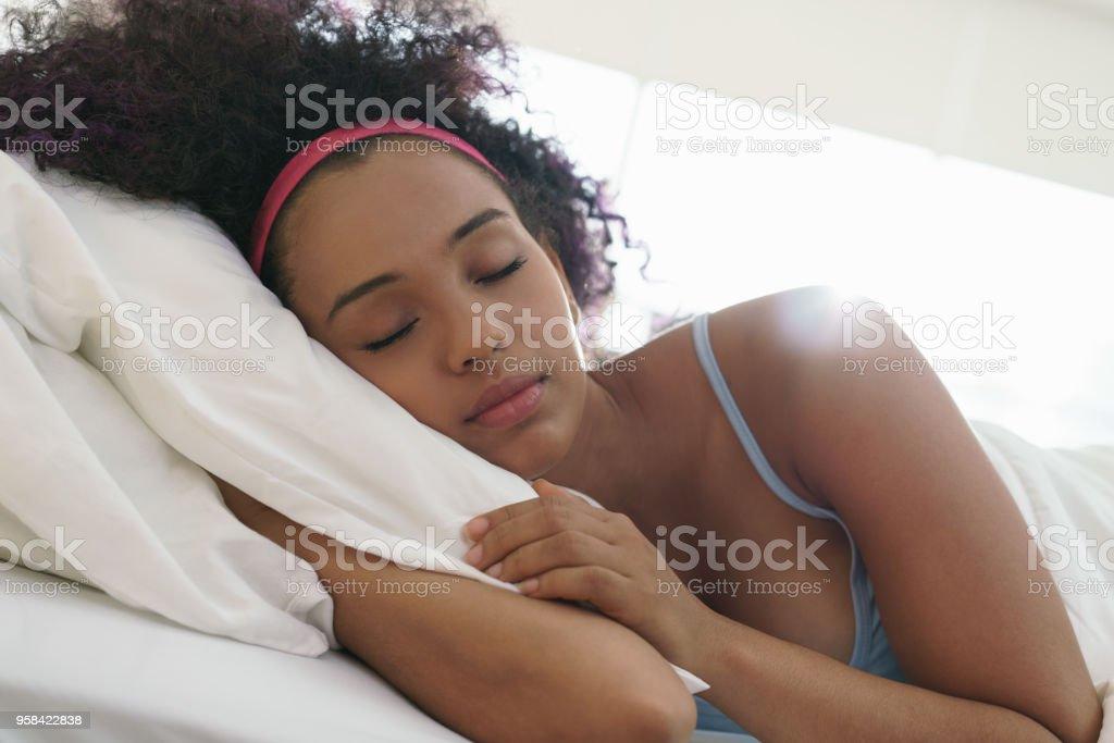 Portrait Of Beautiful Happy Black Girl Waking Up Slow Motion stock photo