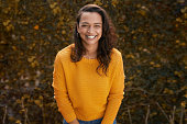 istock Portrait of beautiful happy woman in a yellow jumper 1282523345