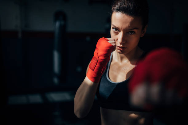 Portrait of beautiful kick  boxer exercising in the gym