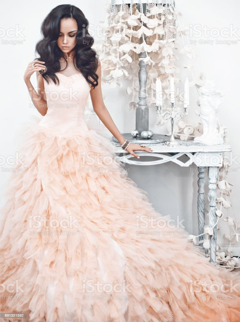 Portrait of beautiful lady in gorgeous couture dress stock photo