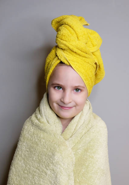 Portrait of beautiful little girl after shower stock photo