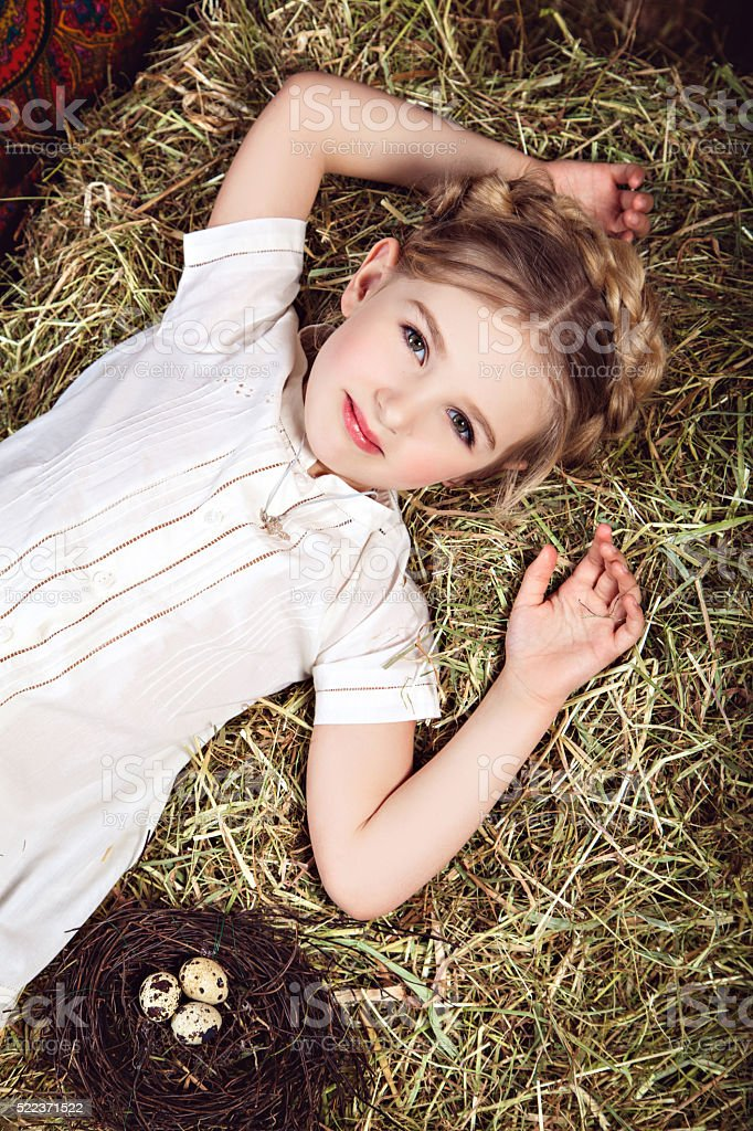 Portrait of beautiful little girl in white dress royalty-free stock photo