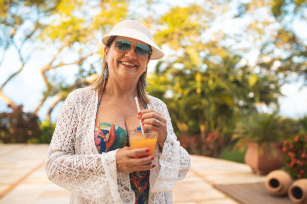 Portrait of beautiful mature woman Cocktail, Summer, Day, Mature Woman, Portrait middle aged women in bikinis stock pictures, royalty-free photos & images