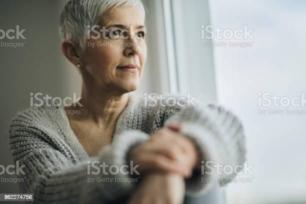 Portrait of beautiful mature woman relaxing by the window picture id862274756?b=1&k=6&m=862274756&s=612x612&h=nvmus6slrmzt5qsqmmpijio perbya0wrbd8nerieju=