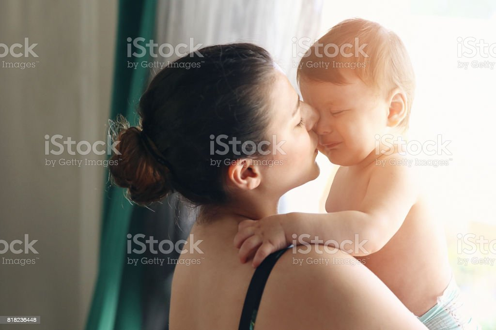 Portrait of beautiful mom with frightened stock photo