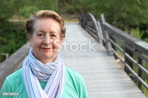 istock Portrait of beautiful older woman smiling 598786524
