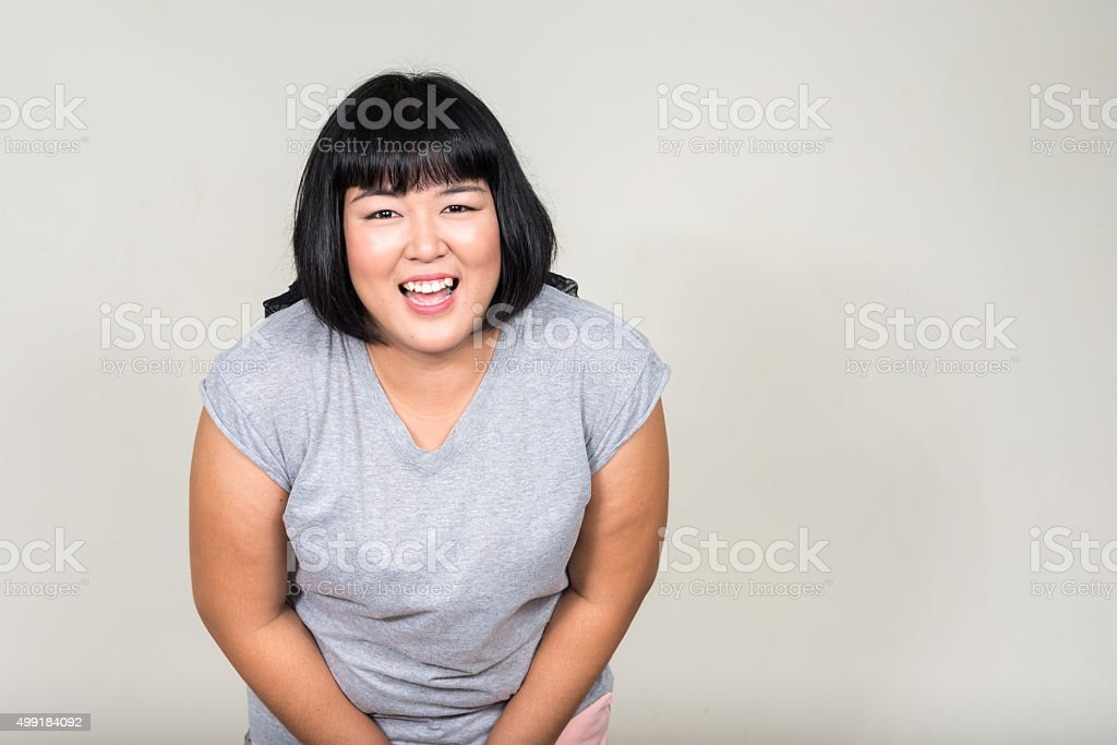 Portrait of beautiful overweight Asian woman smiling圖像檔