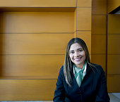 Portrait of beautiful receptionist at a hotel looking at camera smiling very happy
