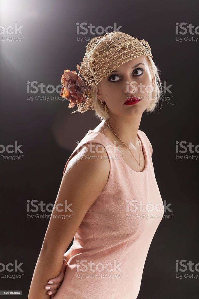 Portrait of beautiful retro-style woman in bonnet royalty-free stock photo